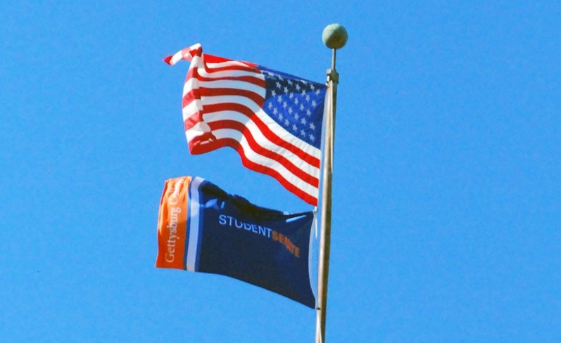 The Student Senate flag flies above Penn Hall