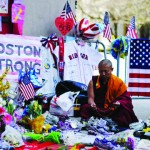 A Buddhist shows support for the victims of the Boston bombings during a moment of silence near the finish line of the Boston Marathon on April 22. Photo by Kevork Djansezian, Getty Images