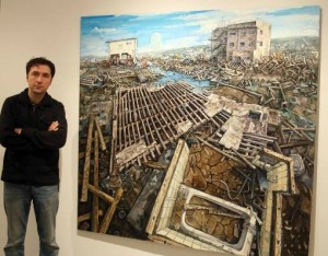 Kobaslija, pictured above with one the paintings for which the artist has received critical praise, focused his efforts on the devestation of Kesennuma, Jappan that followed recent earthquakes and tsunamis. (Photo courtesy of GCC&M)