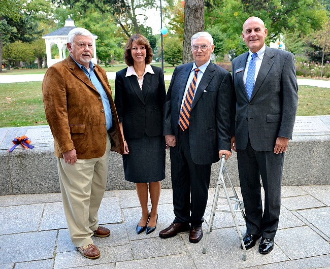 President Janet Morgan Riggs, pictured with Eric Kolbe, Robert Kolbe and Jim Chemel '71, chair of the college's Board of Trustees.