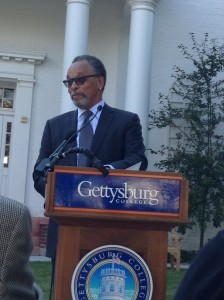 Bruce Gordon '68 speaks about the continuing need for equality at the statue's dedication. Photo courtesy of Julia Sippel.