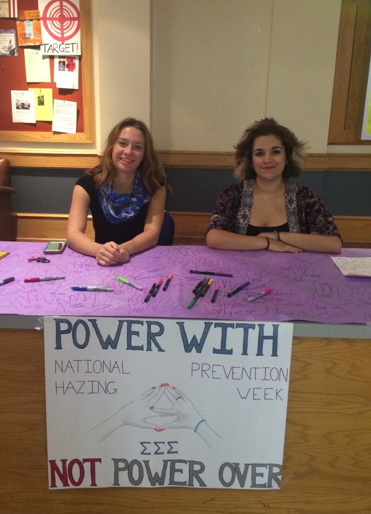 Cait Goodlett '17 (left) and Laura Brumbaugh '17 of Tri Sigma acknowledge NHPW with a CUB table and anti-hazing pledge. Photo credit Nora Tidey.