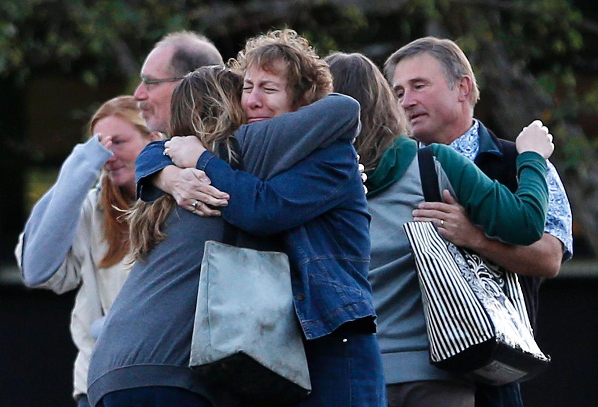 Family members console one another in the wake of the Umpqua Community College shooting. Photo courtesy of nydailynews.com