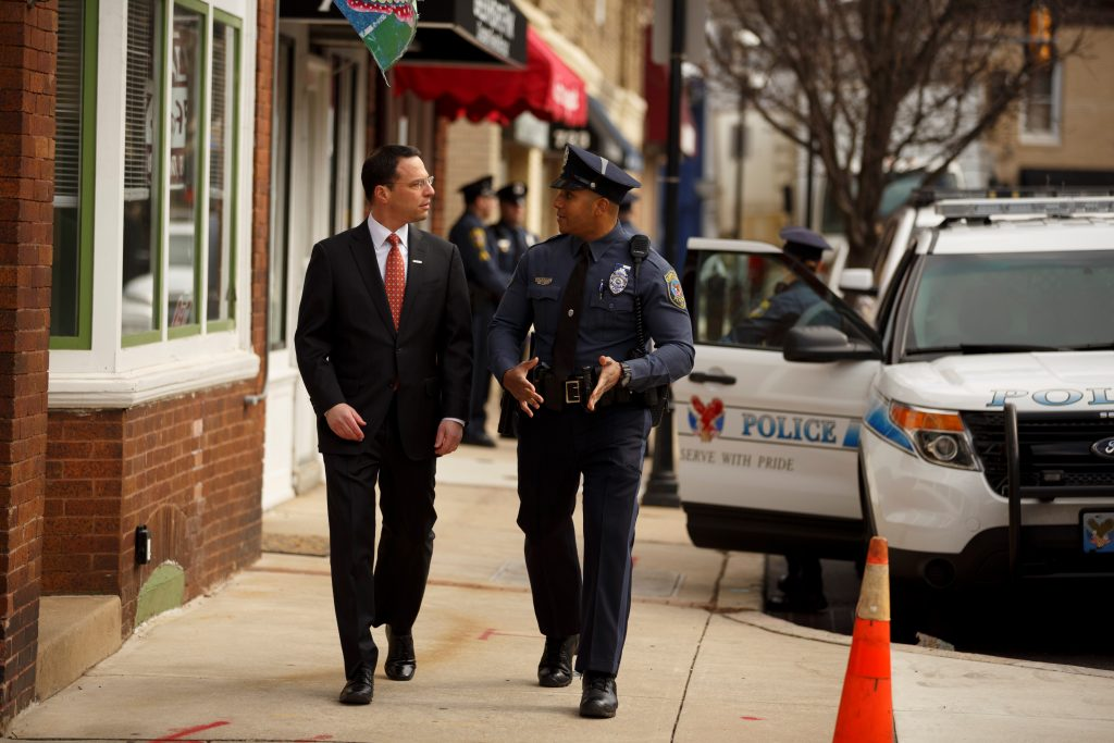 Shapiro walking the beat with a police officer in his hometown. Photo credit: Joe Grace.