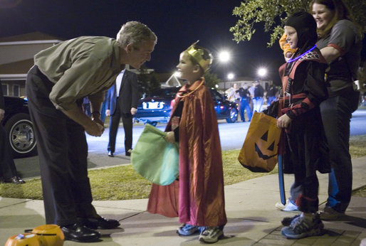 George W. Bush with trick-or-treaters in 2006 (Photo courtesy of The White House)