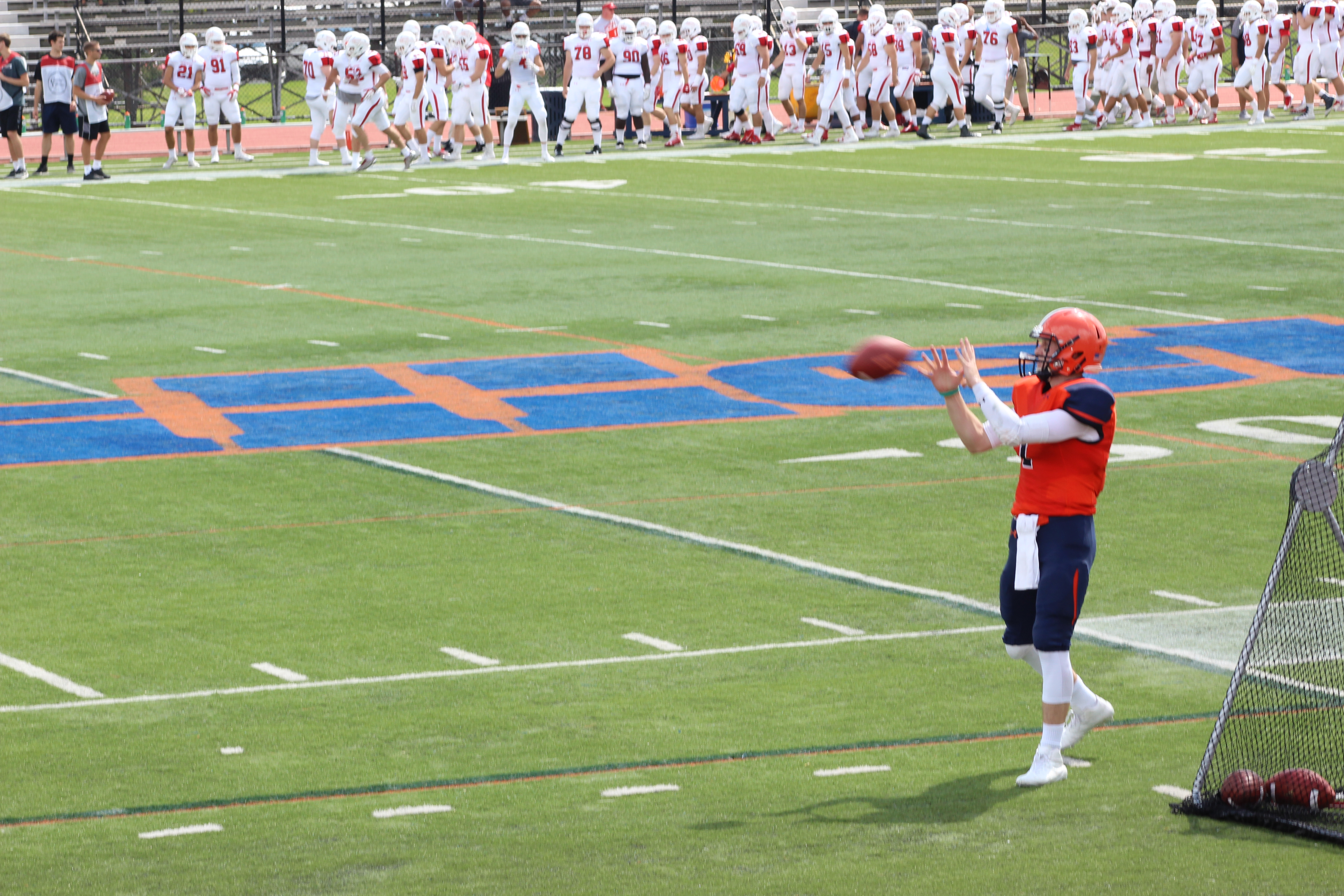 Bullets quarterback Justin Davidov warms up prior to the Homecoming Game against Dickinson (Photo Claire Bickers / The Gettysburgian)