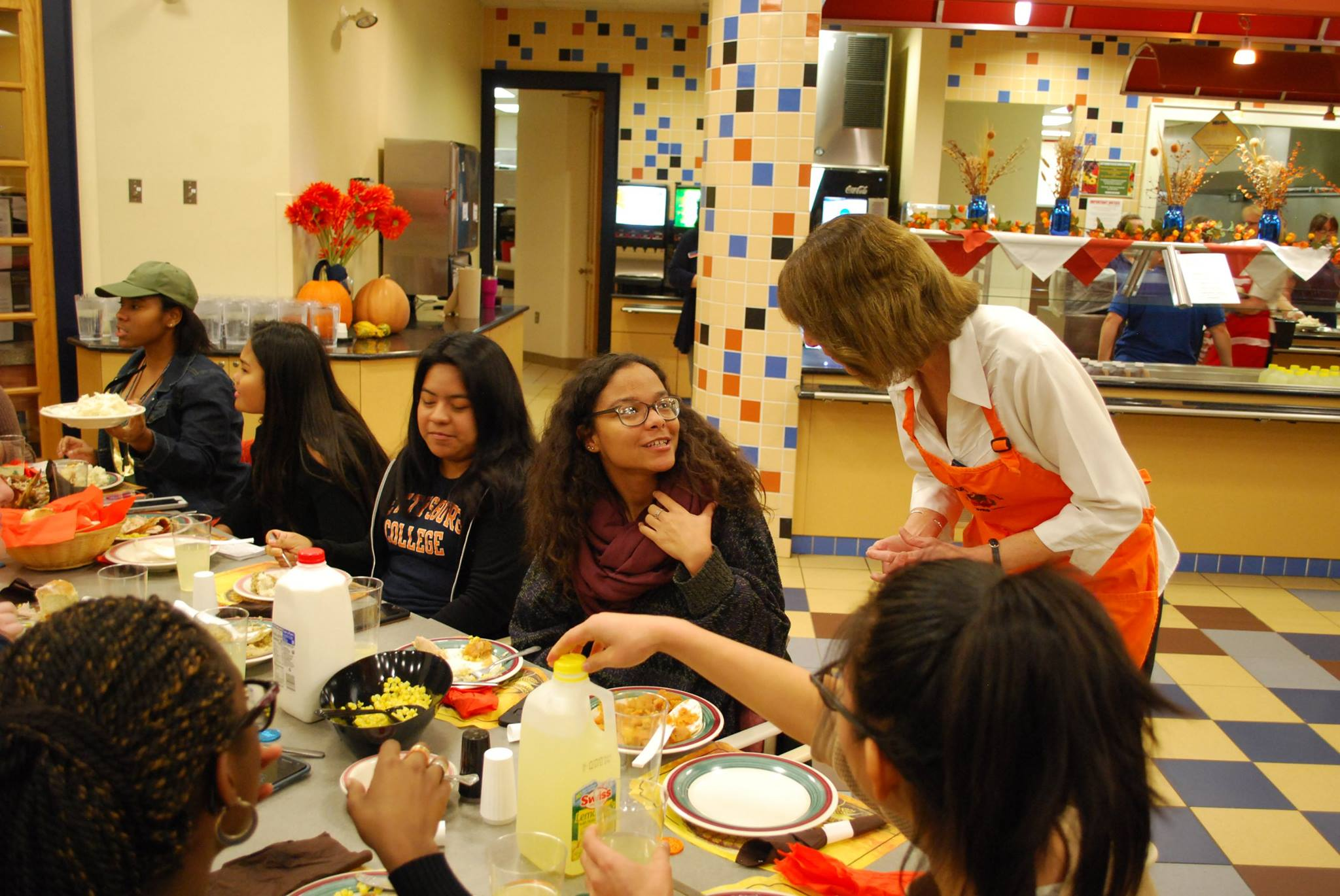 President Janet Morgan Riggs interacts with students at Servo Thanksgiving (Photo Jamie Welch / The Gettysburgian)