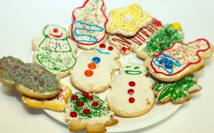 plate of colorfully decorated cookies for Christmas and the holidays