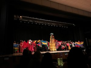 (Photo by Maddie Neiman) Students and La Gigantona represented their countries and cultures on the catwalk.