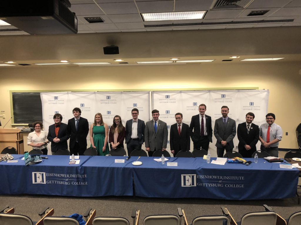 The club representatives pose for a photo after the debate. (Photo Jamie Welch/The Gettysburgian)