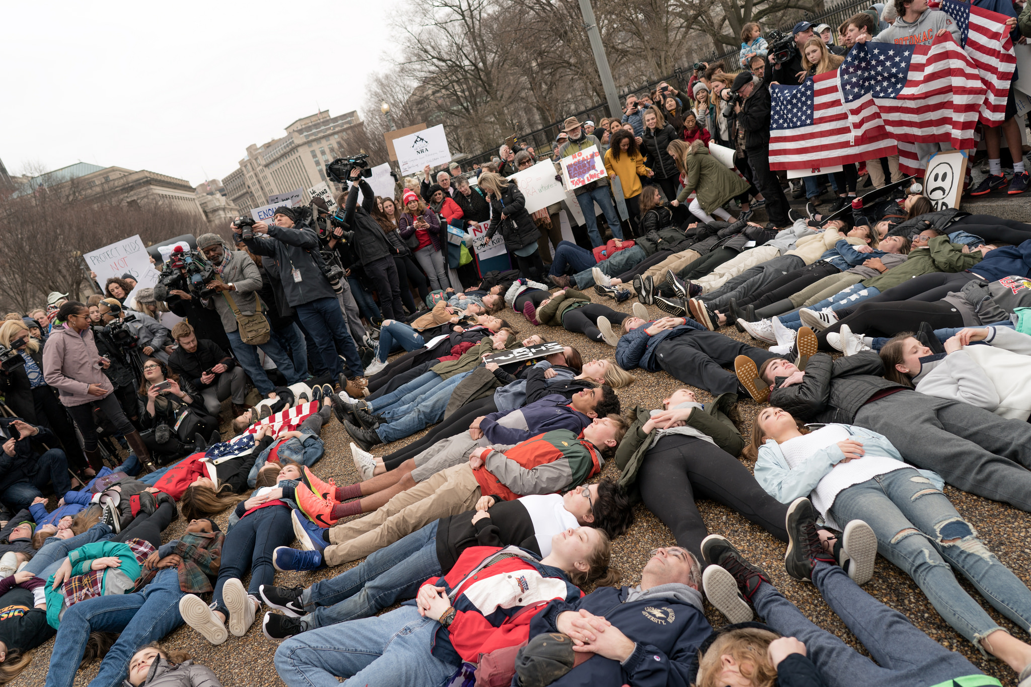 Students lie-in at the White House on Feb. 19 to protest gun laws. The demonstration was organized by Teens For Gun Reform, an organization created by students in the Washington DC area, in the wake of the shooting at Marjory Stoneman Douglas High School in Parkland, Florida. (Photo Lorie Shaull/Flickr)