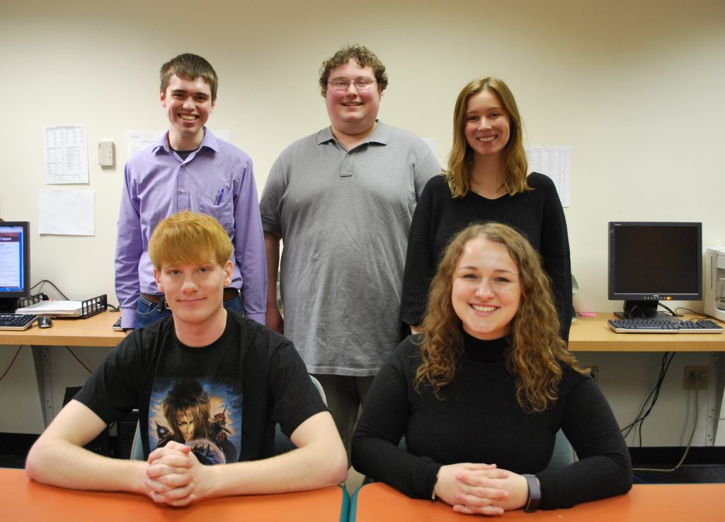 The winners of the PA NewsMedia Association's Student Keystone Press awards pose for a photo in The Gettysburgian's office in the basement of Plank Gymnasium at Gettysburg College. The winners are: front row (L-R): Charlie Sternberg, Samantha Hann; back row (L-R): Benjamin Pontz, Jamie Welch and Daniella Snyder. Not pictured: Joshua Wagner.