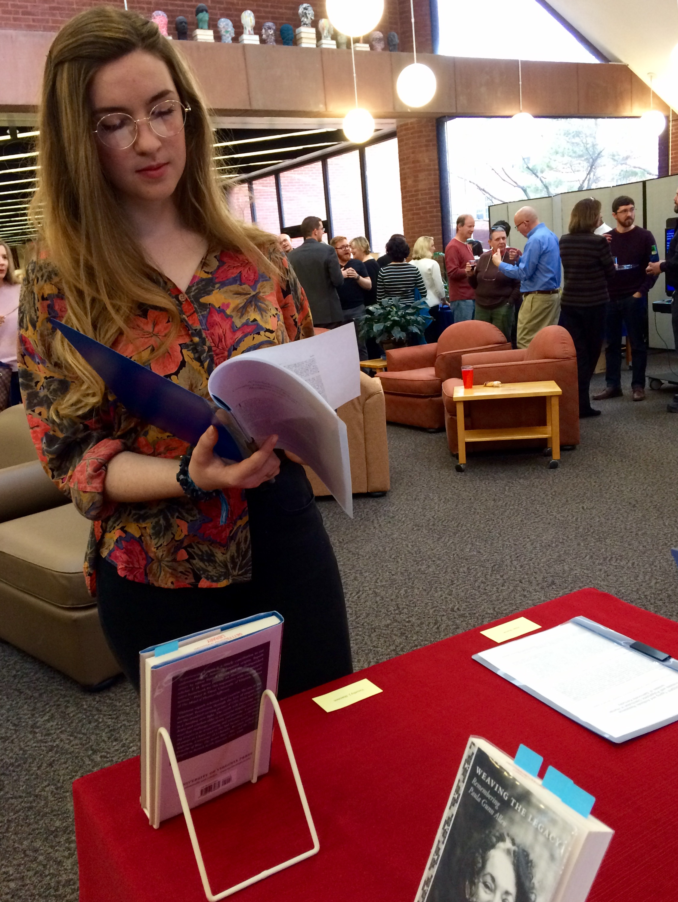 Lily Shea '21 examines one work at the College Authors Reception last week (Photo Julia Chin/The Gettysburgian)