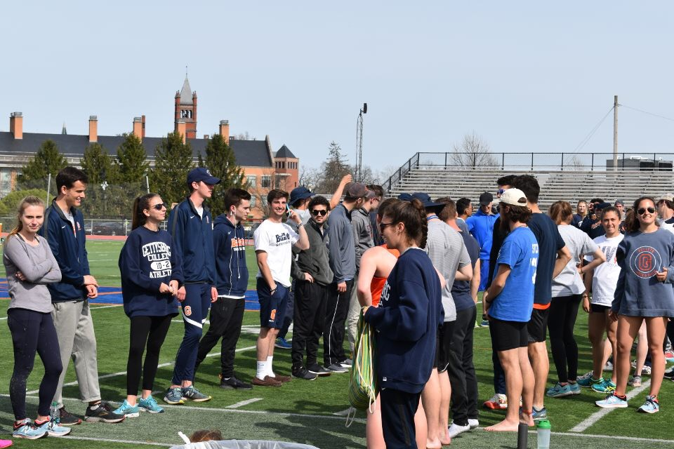 Bullets track and field athletes line the field to honor graduating seniors (Photo courtesy of Colleen Campbell).