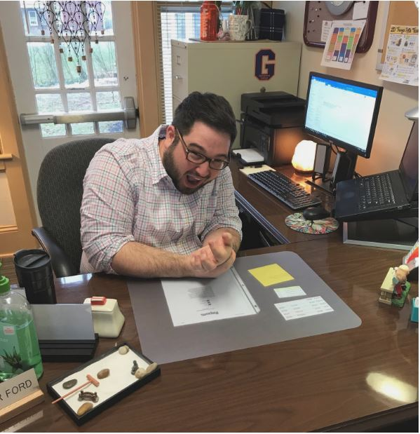 The Center for Career Development's Christopher Ford clutches his wrist in agony due to the carpal tunnel syndrome that he has developed as a result of too much emailing (Photo Maddie Neiman/The Gettysburgian)