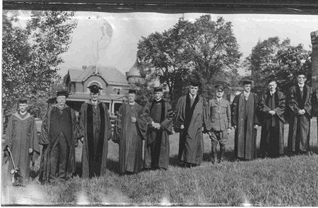 Commencement May 15, 1918. From left: Frederick Ritscher Knubel (Salutorian Class of 1918), Former President William H. Taft, William A. Granville (President of Gettysburg College 1910-1923), members of the faculty. Detail from a panoramic photograph by William H. Tipton. (Photo via Special Collections in Musselman Library)