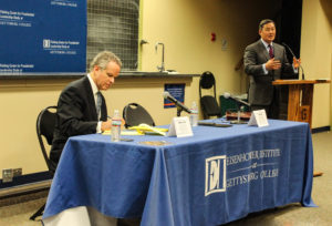 Professor John Yoo makes a point during the Fielding Center's debate as Professor Alberto Coll takes notes (Photo Mary Frasier/The Gettysburgian)