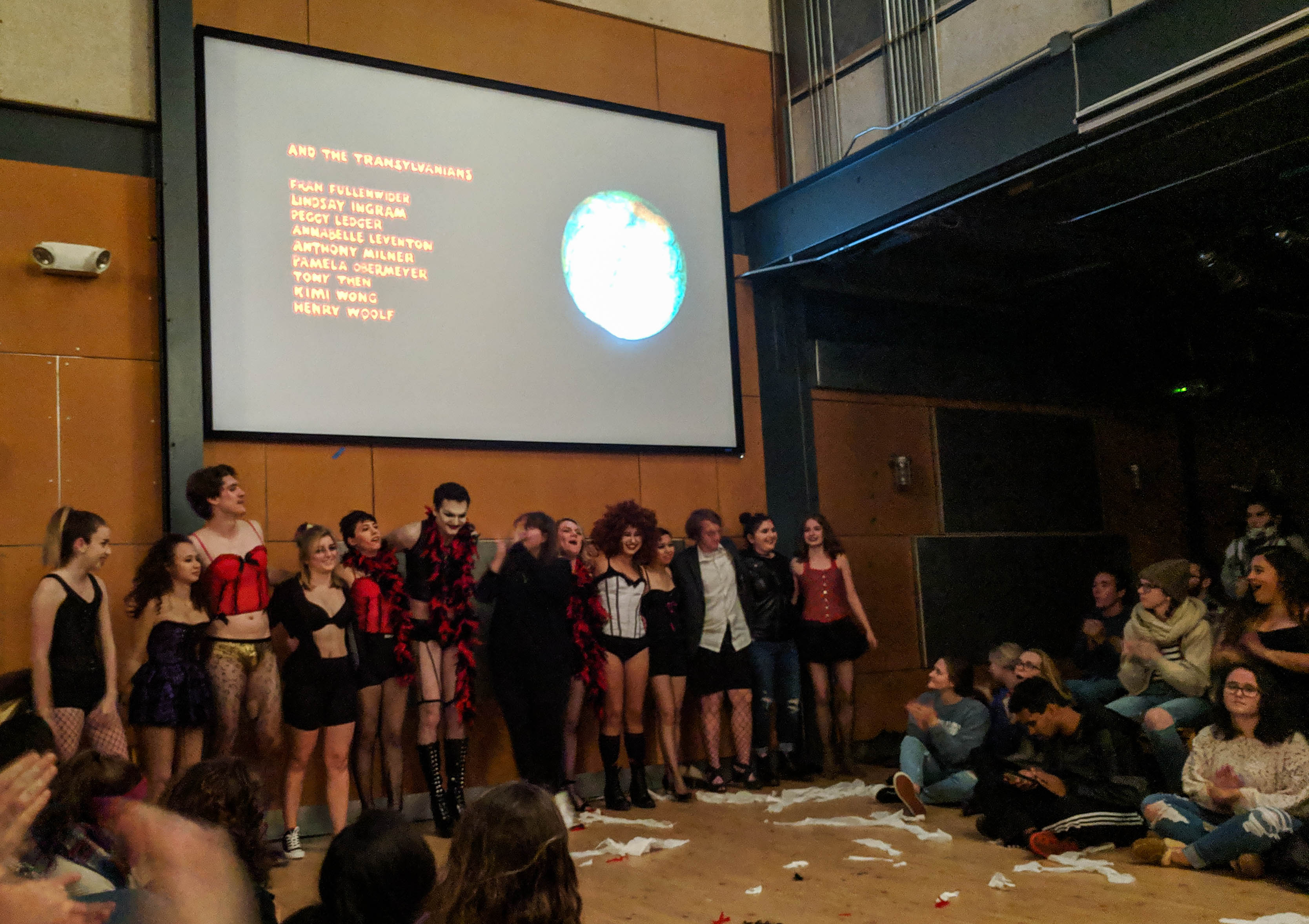"Performing a shadow cast to the cult classic, ""Rocky Horror,"" students dress up as the characters and act in front of the film (Photo Mary Frasier/The Gettysburgian)"