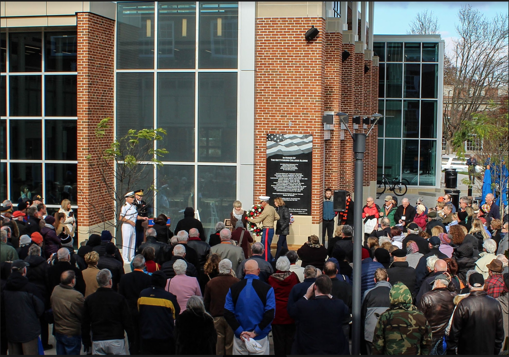 A crowd gathers for the dedication of the Vietnam Memorial outside of the College Union Building. (Photo Mary Frasier/The Gettysburgian)