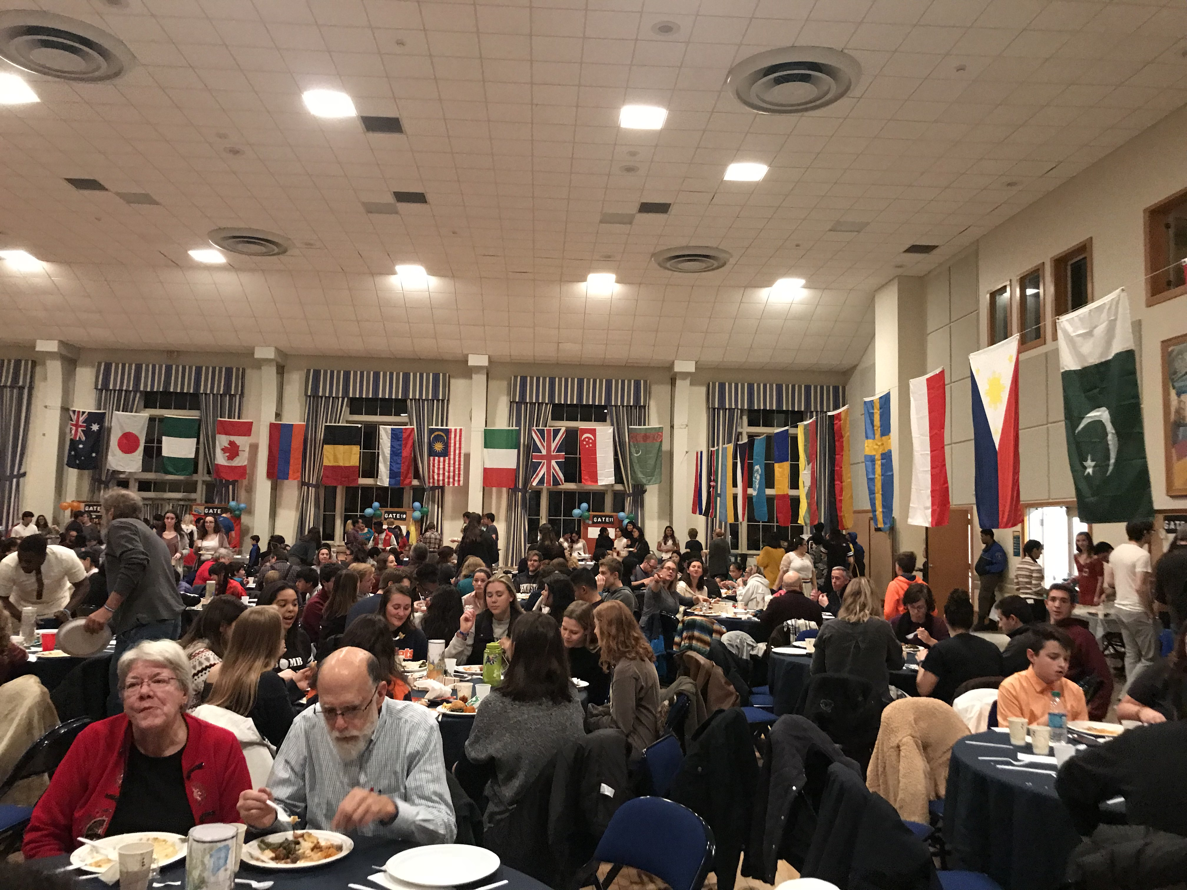 The CUB ballroom, decorated with multicultural flags, hosted a variety of cuisines and performances at this year's Burgburst (Photo Kyra Pfeiffer/The Gettysburgian).