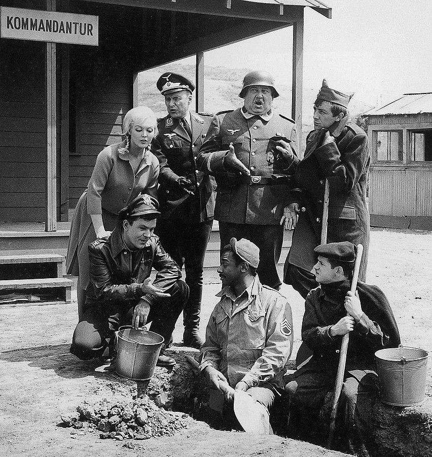 Cast members of Hogan's Heroes in 1965 (Photo via Wikimedia Commons)