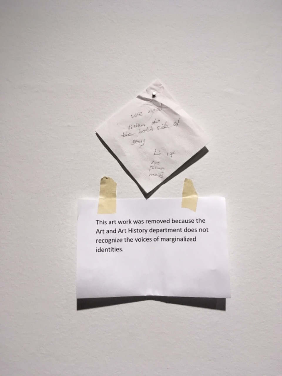 At the exhibit opening, an attendee posted a napkin encouraging dialogue above the note (Photo by Gettysburgian Staff)