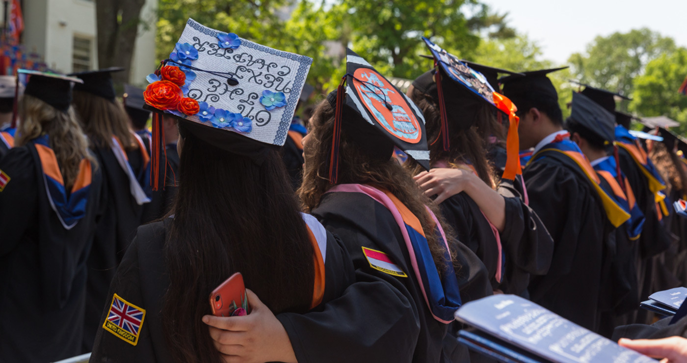 Students stand arm in arm during the 184th commencement exercises (Photo courtesy of Gettysburg College).