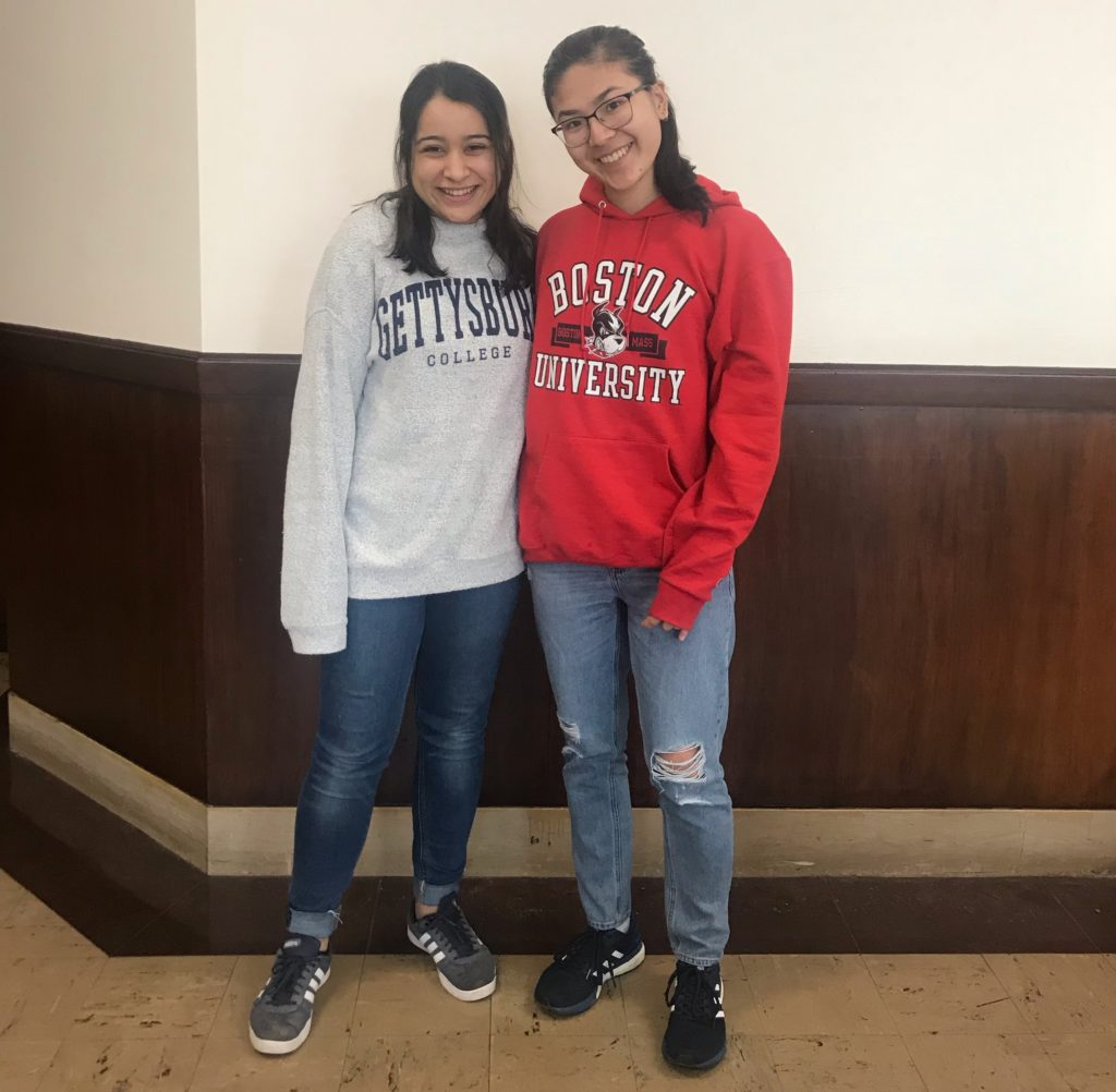 Safiya Amin '23 poses with friend at her high school's decision day (Photo courtesy of Safiya Amin)
