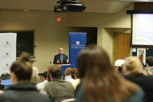 Iuliano introduces the speaker at his civil discourse series (Photo courtesy of the Eisenhower Institute)
