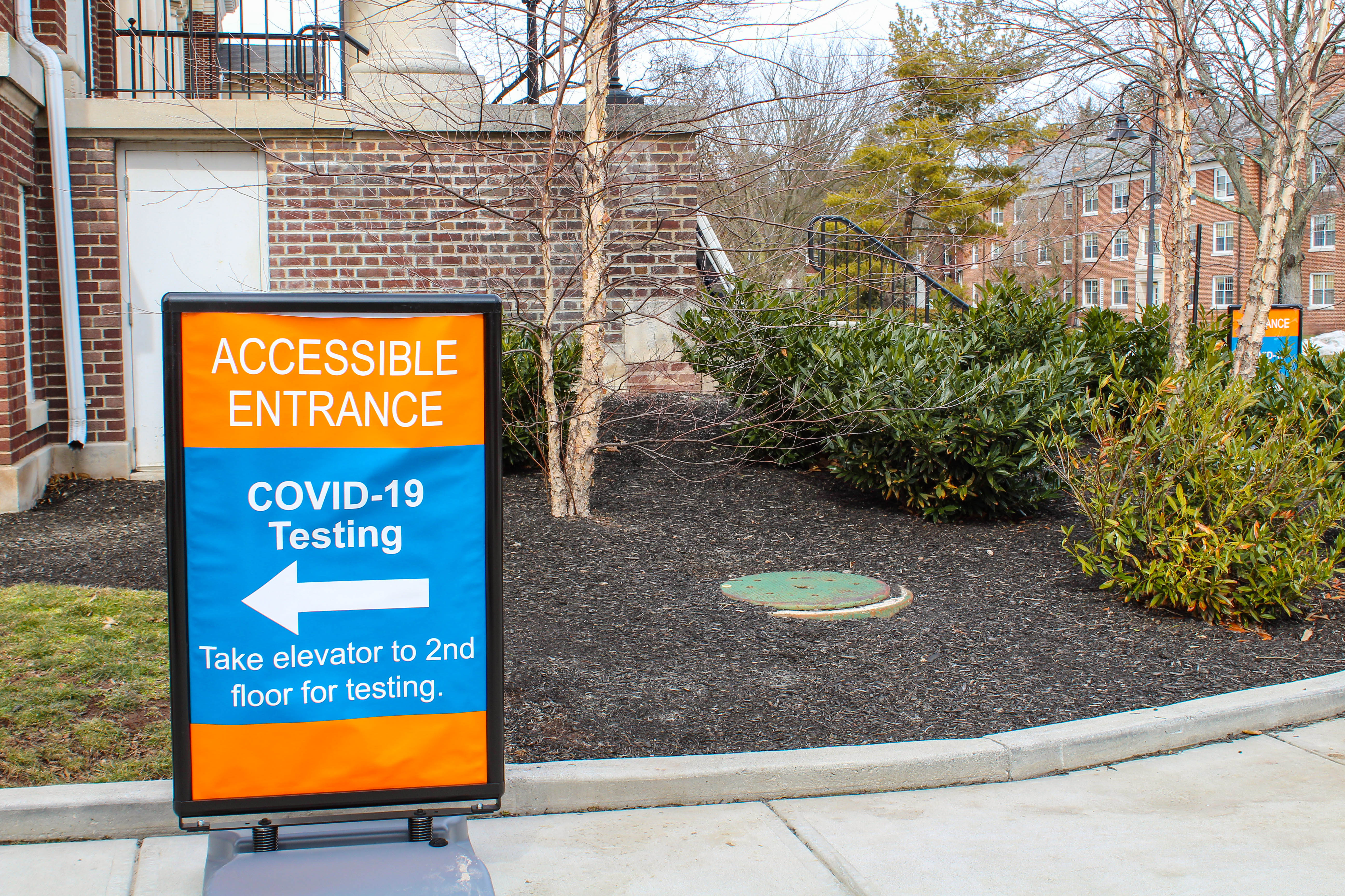 A sign directs students towards the accessible entrance for COVID-19 testing at Plank Gym. The college tests students twice a week as part of their updated health guidelines. Students who do not attend their COVID-19 tests are subject to sanctions outlined in the behavior rubric, and may include reassignment to remote study. (Photo Mary Frasier/The Gettysburgian)