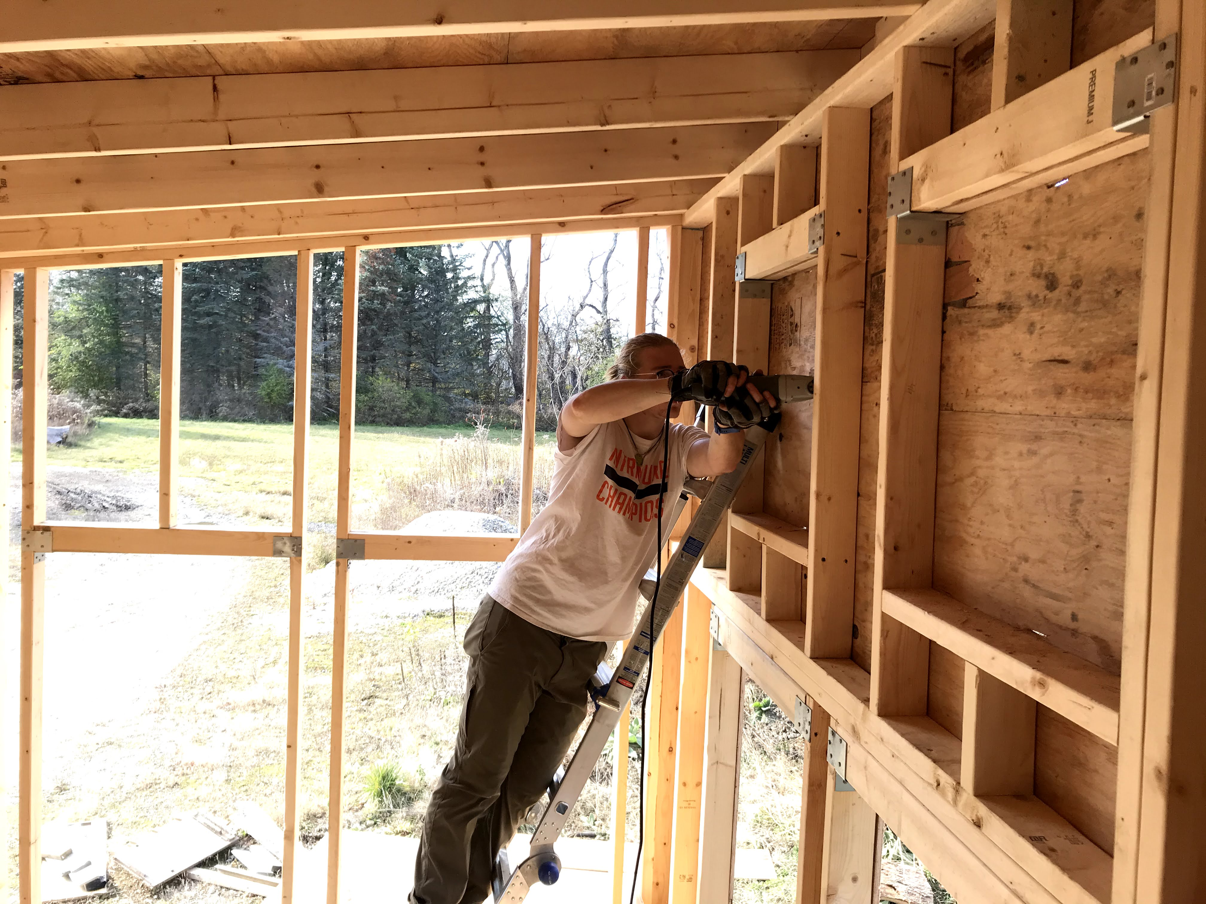 Zach de Besche working to construct the tiny house for his environmental studies capstone project (Photo courtesy of Julia Sharapi)