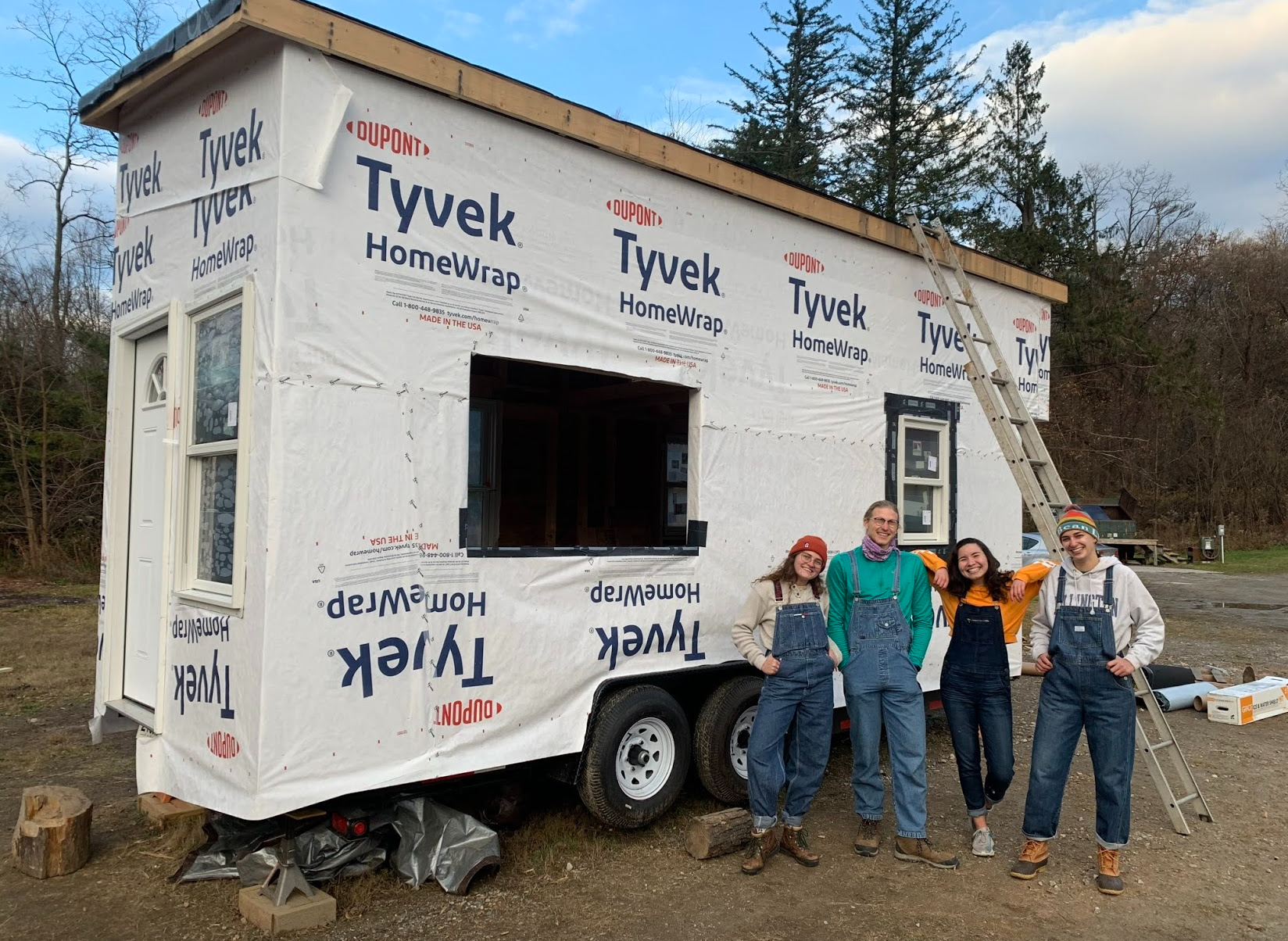 Students (from left) Diana Biesecker '22, Zach de Besche '22, Julia Sharapi '22, and Nicole Melnick '23 in front of the tiny house they constructed during the fall 2020 semester (Photo courtesy of Julia Sharapi)