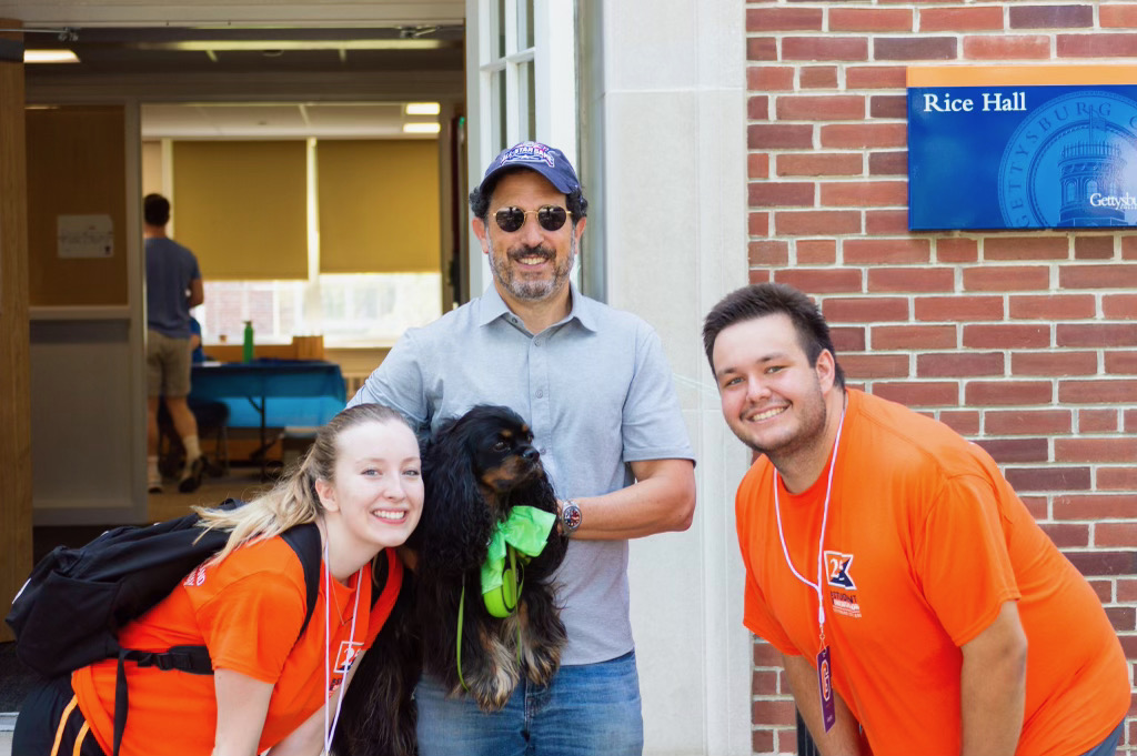 A furry friend joins orientation volunteers outside of Rice Hall (Photo Aly Wein/The Gettysburgian)