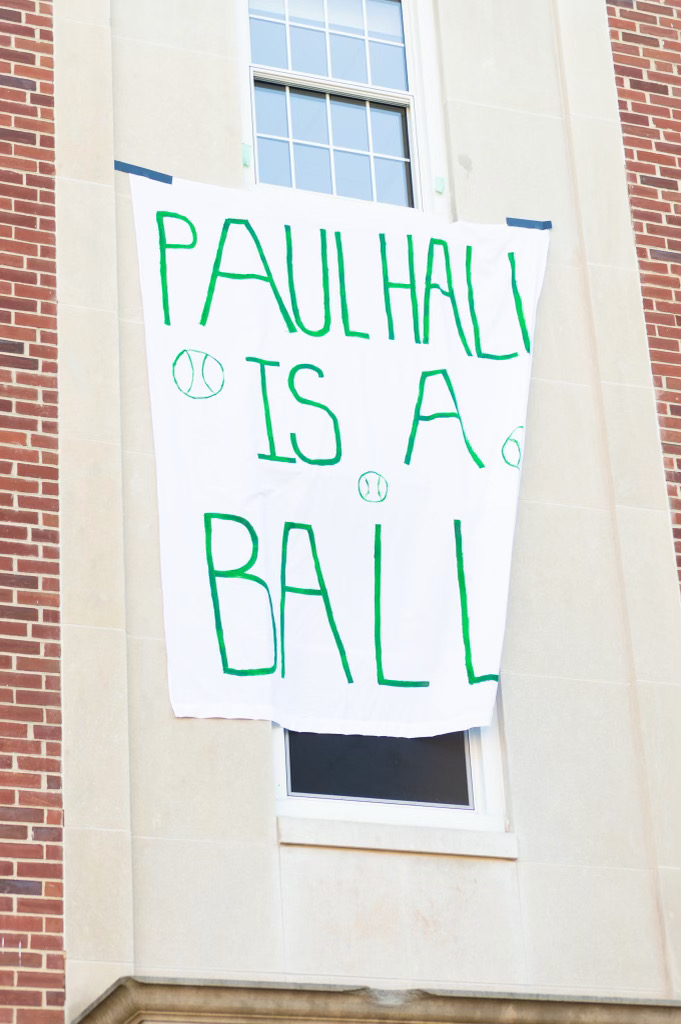 """""""Paul Hall is a Ball"""" waves the flag on the wall (Photo Aly Wein/The Gettysburgian)"""