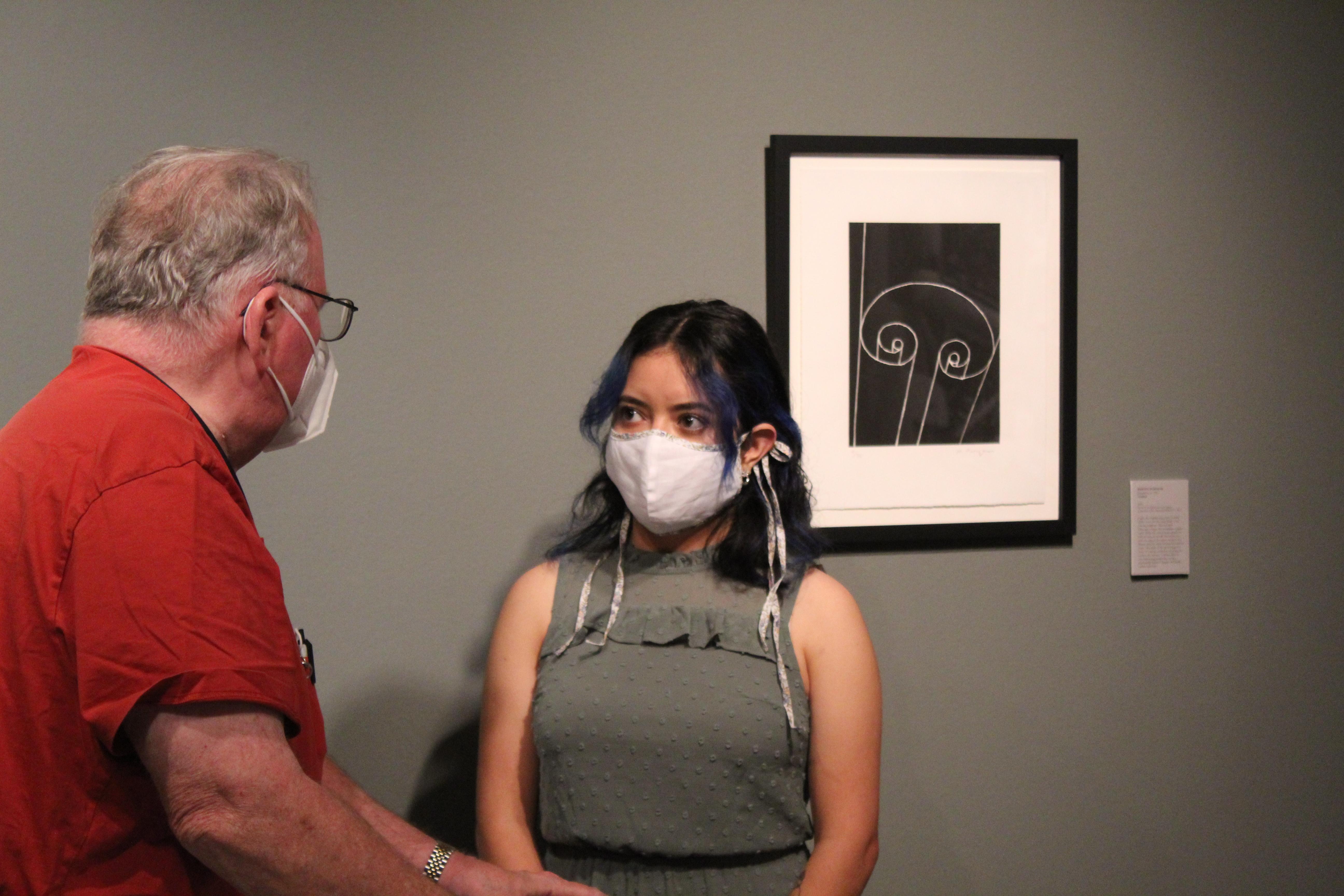 Merlyn Maldonado Lopez '21 discussing the exhibit at the Schmucker Art Gallery (Photo Maggie Galloway/The Gettysburgian)